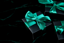black box with green bow